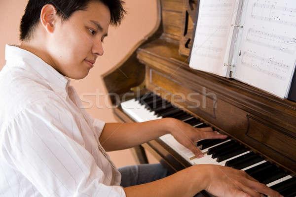 Asian playing piano Stock photo © aremafoto
