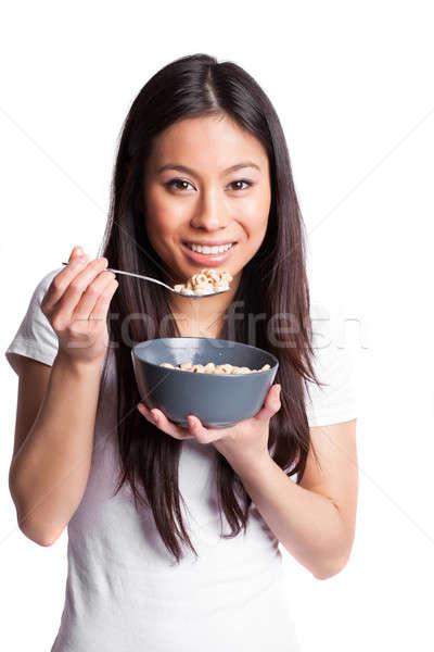 Asian vrouw eten granen geïsoleerd shot Stockfoto © aremafoto