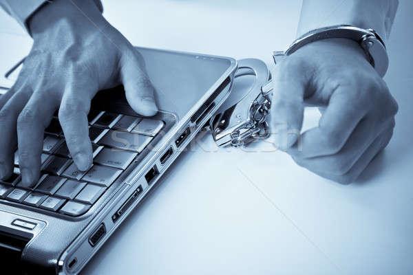 Handcuffed businessman on laptop Stock photo © aremafoto