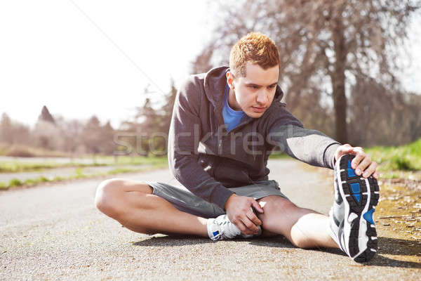 Mixed race man stretching Stock photo © aremafoto