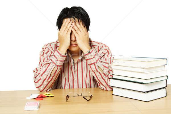 Tanulás kártyapakli izolált lövés hangsúlyos fiatalember Stock fotó © aremafoto