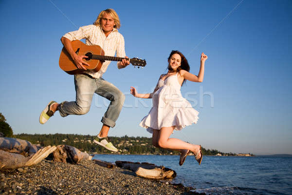 Jumping couple in happiness Stock photo © aremafoto