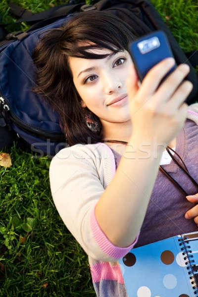 Félvér diák sms chat lövés lány telefon Stock fotó © aremafoto