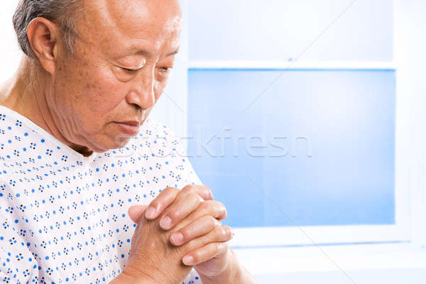 Praying senior asian in hospital Stock photo © aremafoto