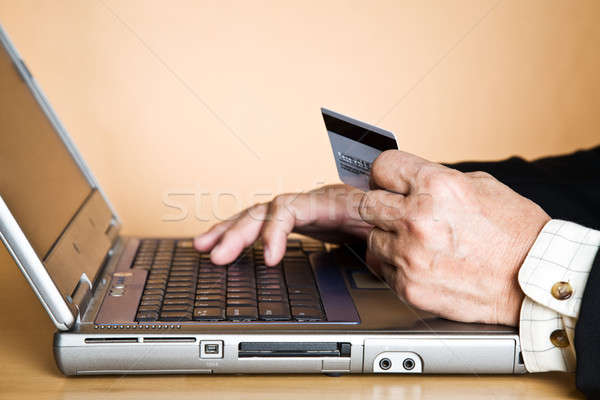 Senior businessman buying online Stock photo © aremafoto