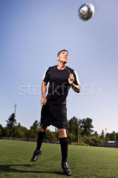 Hispanic soccer or football player heading a ball Stock photo © aremafoto