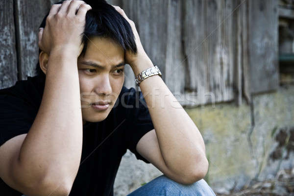 Stressed asian male Stock photo © aremafoto