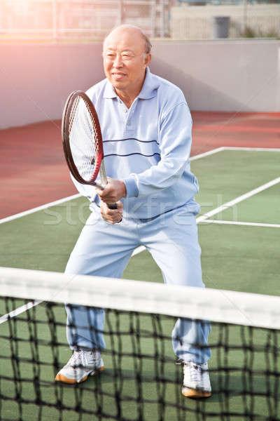 Idős teniszező lövés ázsiai férfi játszik Stock fotó © aremafoto