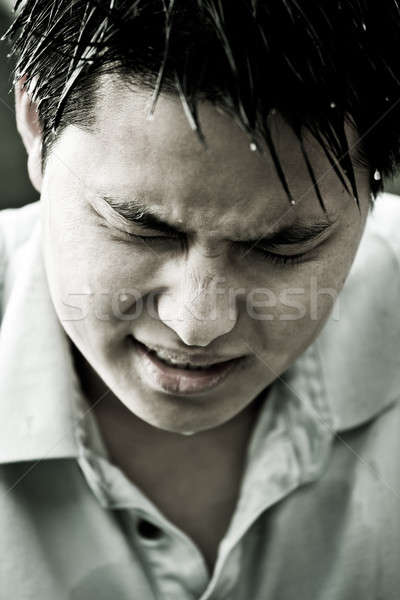 Sad and depressed young asian man Stock photo © aremafoto