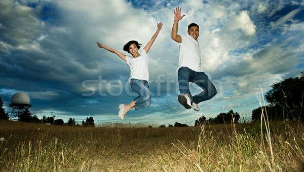 Asian couple jumping in joy Stock photo © aremafoto