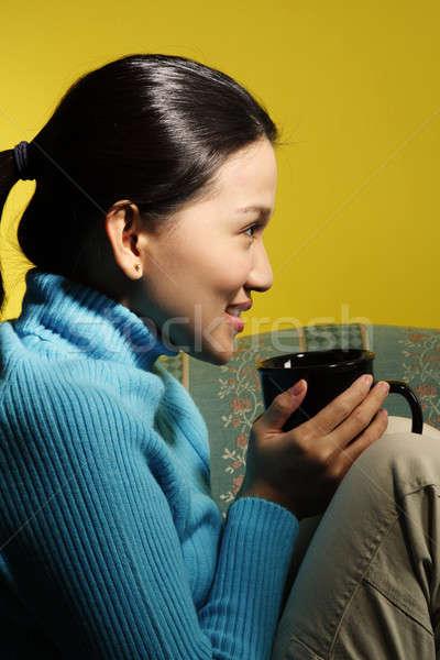 расслабляющая красивой сидят диван Сток-фото © aremafoto
