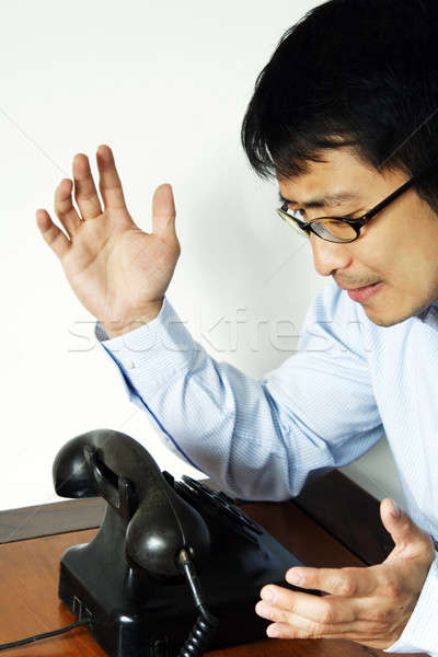 Zakenman ongeduldig uit wachten telefoongesprek Stockfoto © aremafoto