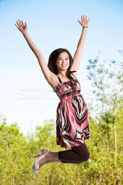Jumping for joy Stock photo © aremafoto