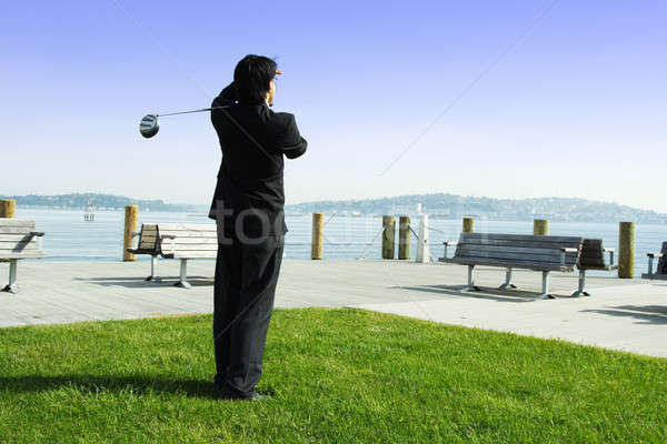 Golfing businessman Stock photo © aremafoto