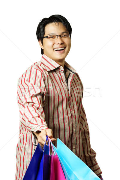Vásárlás izolált lövés fiatalember hordoz bevásárlótáskák Stock fotó © aremafoto