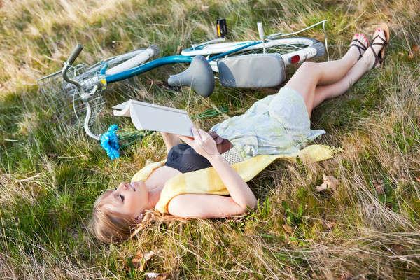 Beautiful Caucasian woman reading outdoor Stock photo © aremafoto