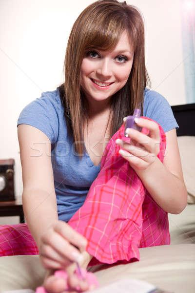 Teenager polishing her nails Stock photo © aremafoto