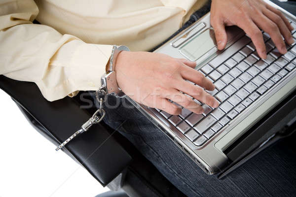 Handcuffed working businessman Stock photo © aremafoto