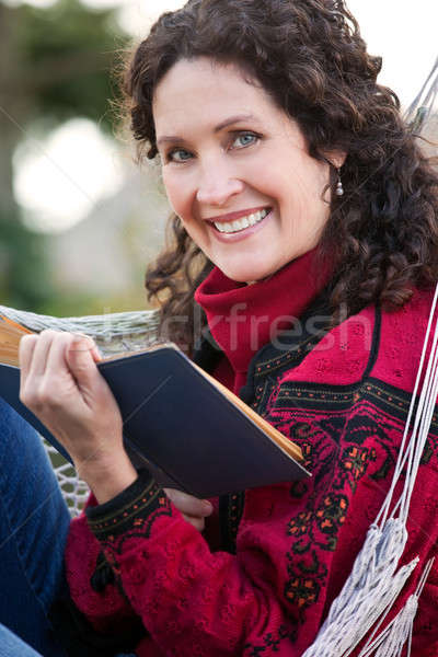 Stock photo: Mature woman reading a book