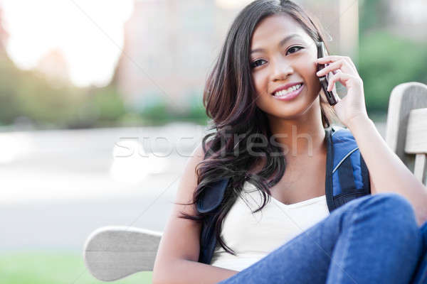 Stock photo: Asian student on the phone