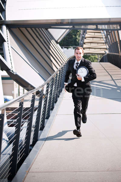 Late caucasian businessman in a rush Stock photo © aremafoto