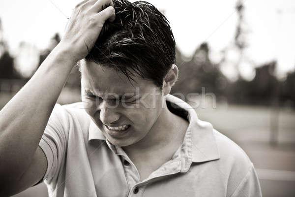 üzücü genç Asya erkek siyah beyaz Stok fotoğraf © aremafoto