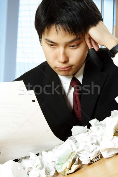 Stressed asian businessman Stock photo © aremafoto