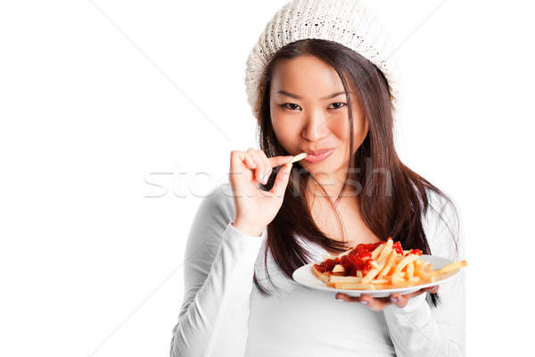 Manger frites françaises isolé coup asian fille Photo stock © aremafoto