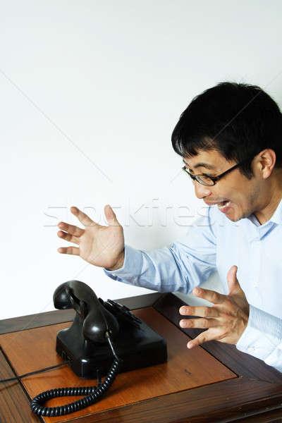 Işadamı sabırsız çığlık atan telefon iş Stok fotoğraf © aremafoto