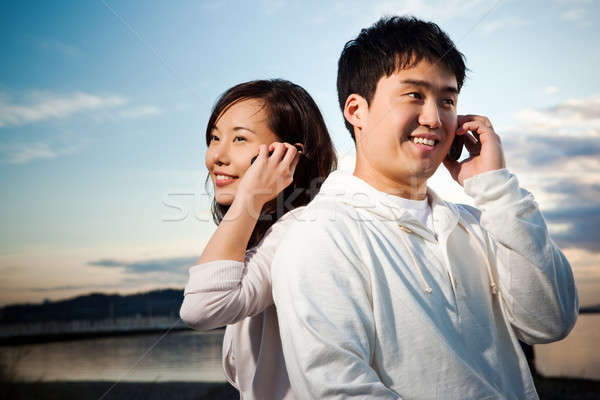 Stock photo: Asian couple on the phone