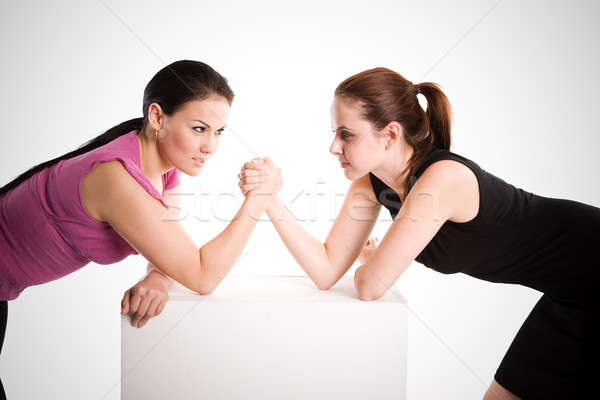 Two businesswomen arm wrestling Stock photo © aremafoto
