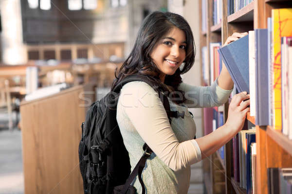 Asian student in library Stock photo © aremafoto