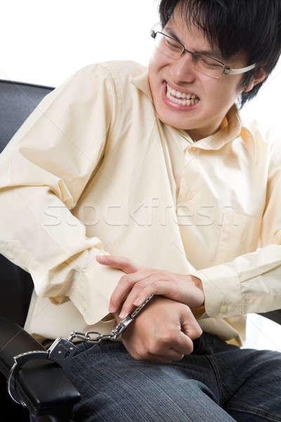 ázsiai üzletember megbilincselve lövés irodai szék kezek Stock fotó © aremafoto