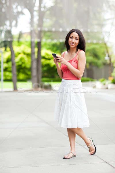 Woman texting Stock photo © aremafoto