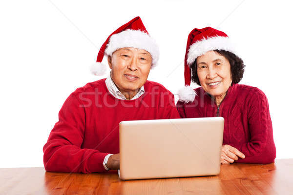 Senior Asian grandparents using computer Stock photo © aremafoto
