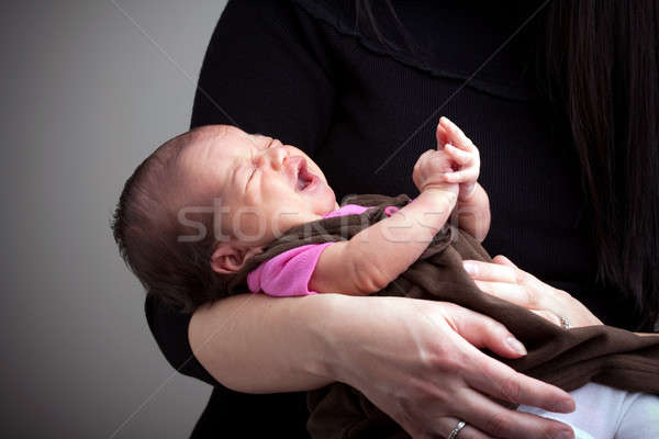 Mother Holding a Screaming Baby Stock photo © ArenaCreative