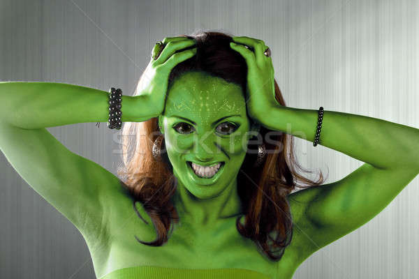Verde alienígena mulher posando prata metal Foto stock © ArenaCreative