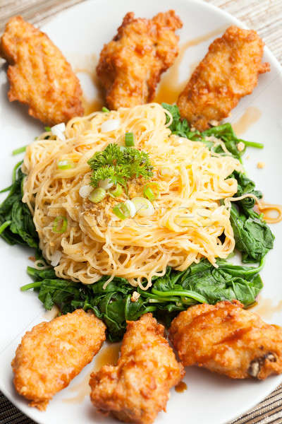 Chicken Wings with Noodles and Spinach Stock photo © ArenaCreative