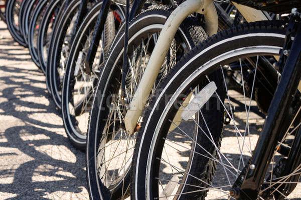 Row of Bicycle Tires Stock photo © ArenaCreative