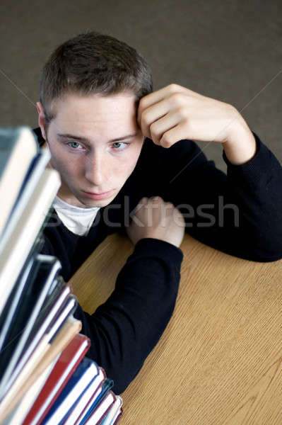 Overloaded Student Looking At Pile of Books Stock photo © ArenaCreative