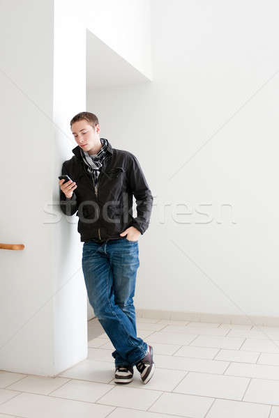 Man Looking At His Cell Phone Stock photo © ArenaCreative