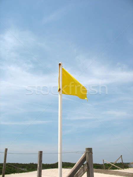 Giallo cautela bandiera sabbia spiaggia cielo Foto d'archivio © ArenaCreative
