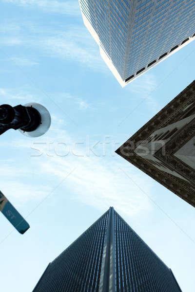 Magas város épületek felhőkarcolók építészet alatt Stock fotó © arenacreative