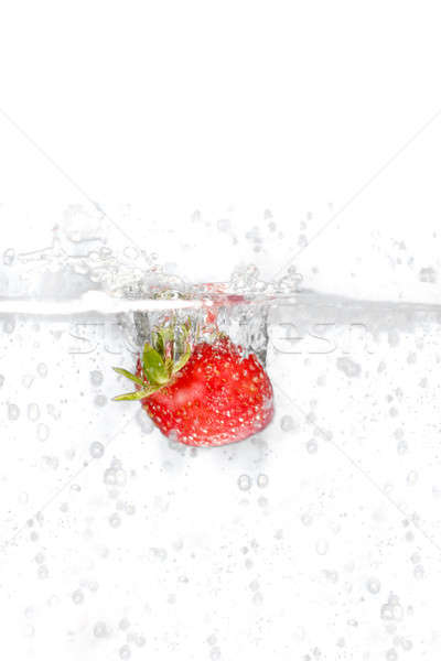 Strawberry Splashing Into Water Stock photo © ArenaCreative