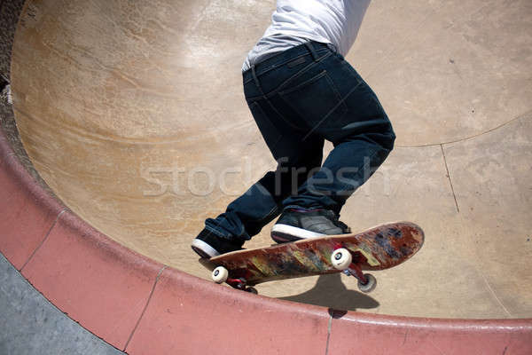 Skateboarder Skating Inside the Bowl Stock photo © ArenaCreative