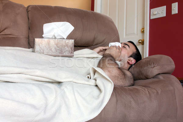 Sick Man on the Couch Stock photo © ArenaCreative