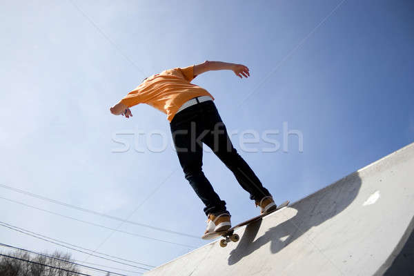 Skateboarder rampe action coup adolescent patinage Photo stock © ArenaCreative