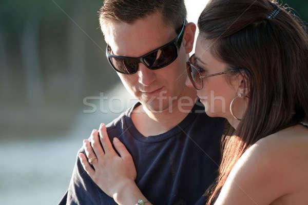 Szomorú pár együtt kint visel napszemüveg Stock fotó © ArenaCreative
