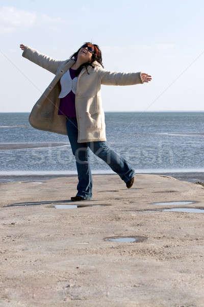Woman Dancing at the Beach Stock photo © ArenaCreative