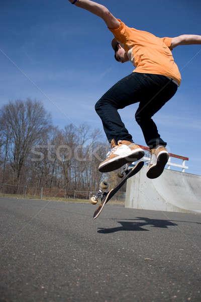 Stock photo: Skateboarder Jumping